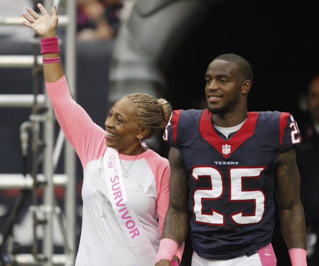 Kareem Jackson of the Houston Texans and his mom, who is a breast cancer survivor, at Reliant Stadium in 2013. (Photo: Bob Levey/Getty Images)