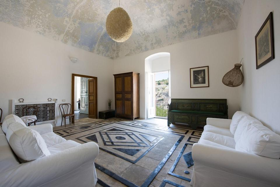 """Built in the UNESCO World Heritage Site of Modica's Old Town, this Sicilian apartment has original stone floors from the 18th century. Despite its history, the home is filled with modern amenities, including a washer/dryer, air conditioning, and Wi-Fi. The host also offers a portable Wi-Fi device for trips to the coastal beaches, about 20 to 30 minutes away by car. Architecturally stunning, it has its own private, cobble-stoned backyard, large living spaces with impossibly high ceilings, and two bedrooms—one with a single bed, the other with a double. While <a href=""""https://www.cntraveler.com/galleries/2016-05-19/why-noto-sicily-is-our-italy-destination-of-the-summer?mbid=synd_yahoo_rss"""" rel=""""nofollow noopener"""" target=""""_blank"""" data-ylk=""""slk:farther away from major Sicilian cities"""" class=""""link rapid-noclick-resp"""">farther away from major Sicilian cities</a> (Palermo is a three-hour drive away, Catania about an hour and a half), you can fly into the Comiso airport about 20 minutes away. $193, Airbnb (Starting Price). <a href=""""https://www.airbnb.com/rooms/1632739"""" rel=""""nofollow noopener"""" target=""""_blank"""" data-ylk=""""slk:Get it now!"""" class=""""link rapid-noclick-resp"""">Get it now!</a>"""