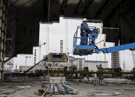 An employee works on the New Safe Confinement (NSC) structure at the site of the Chernobyl nuclear power plant, Ukraine, March 23, 2016. REUTERS/Gleb Garanich