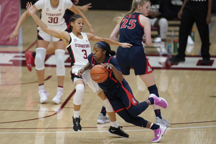 Arizona guard Aari McDonald, middle, drives against Stanford guard Anna Wilson (3) during the first half of an NCAA college basketball game in Stanford, Calif., Monday, Feb. 22, 2021. (AP Photo/Jeff Chiu)