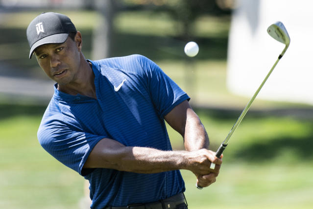 Tiger Woods chips the ball to the ninth hole during a practice round for the BMW championship golf tournament at the Aronimink Golf Club in Newtown Square, Pa., Tuesday, Sept. 4, 2018. (Jose F. Moreno/The Philadelphia Inquirer via AP)