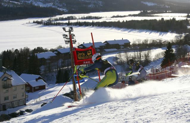 France's Clement Noel, left, and Sweden's Mattias Hargin speed down the course during the Team Event, at the alpine ski World Cup finals in Are, Sweden, Friday, March 16, 2018. (AP Photo/Alessandro Trovati)