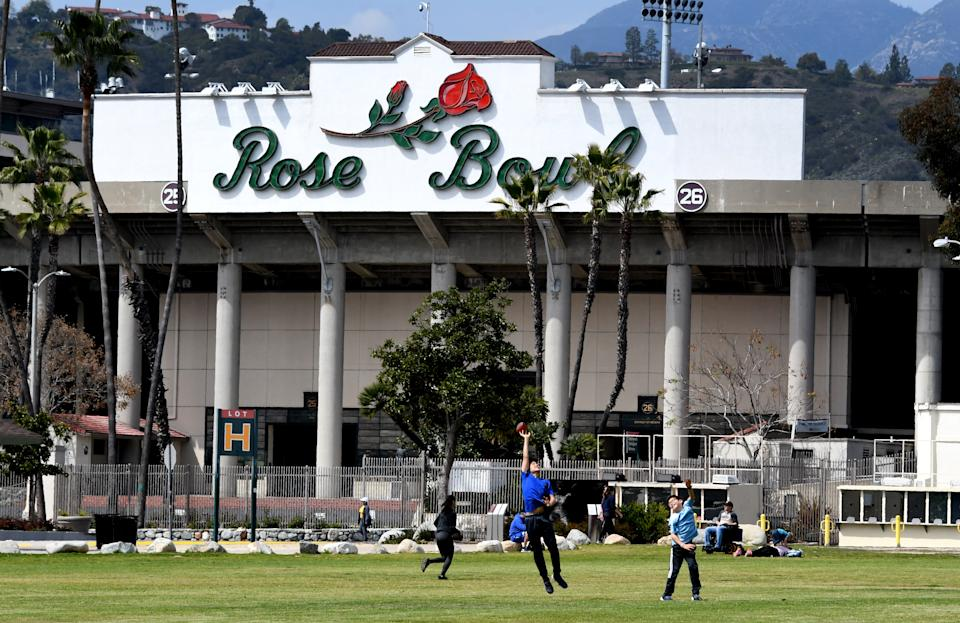 Joggers, walkers, bicyclists and kids play in front of the Rose Bowl while trying to social distance during the coronavirus pandemic on March 28. (Keith Birmingham/MediaNews Group/Pasadena Star-News via Getty Images)