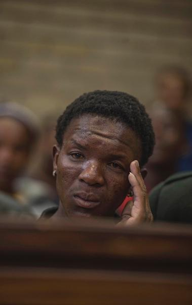 Victor Mlotshwa -- who was filmed being pushed into a coffin -- listens to evidence at the Middleburg Magistrate Court on November 16, 2016 (AFP Photo/Mujahid Safodien)