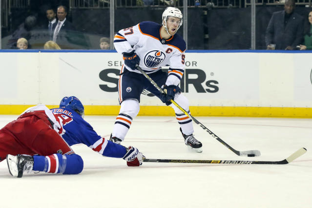 Edmonton Oilers center Connor McDavid (97) skates against New York Rangers defenseman Marc Staal (18) during the third period of an NHL hockey game, Saturday, Oct. 12, 2019, at Madison Square Garden in New York. The Oilers won 4-1. (AP Photo/Mary Altaffer)
