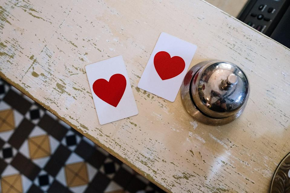 """<p> Want to play a game of hearts? </p> <p><a href=""""http://media1.popsugar-assets.com/files/2021/01/04/010/n/1922507/99e55fb48e478928_pexels-cottonbro-5137956/i/valentine-day-zoom-backgrounds.jpg"""" class=""""link rapid-noclick-resp"""" rel=""""nofollow noopener"""" target=""""_blank"""" data-ylk=""""slk:Download this Zoom background image here."""">Download this Zoom background image here. </a></p>"""