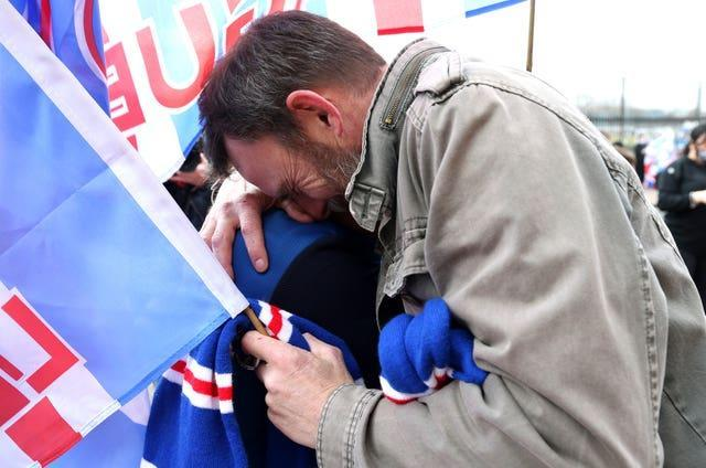 One Rangers fan is overcome by emotion as he celebrates the title triumph