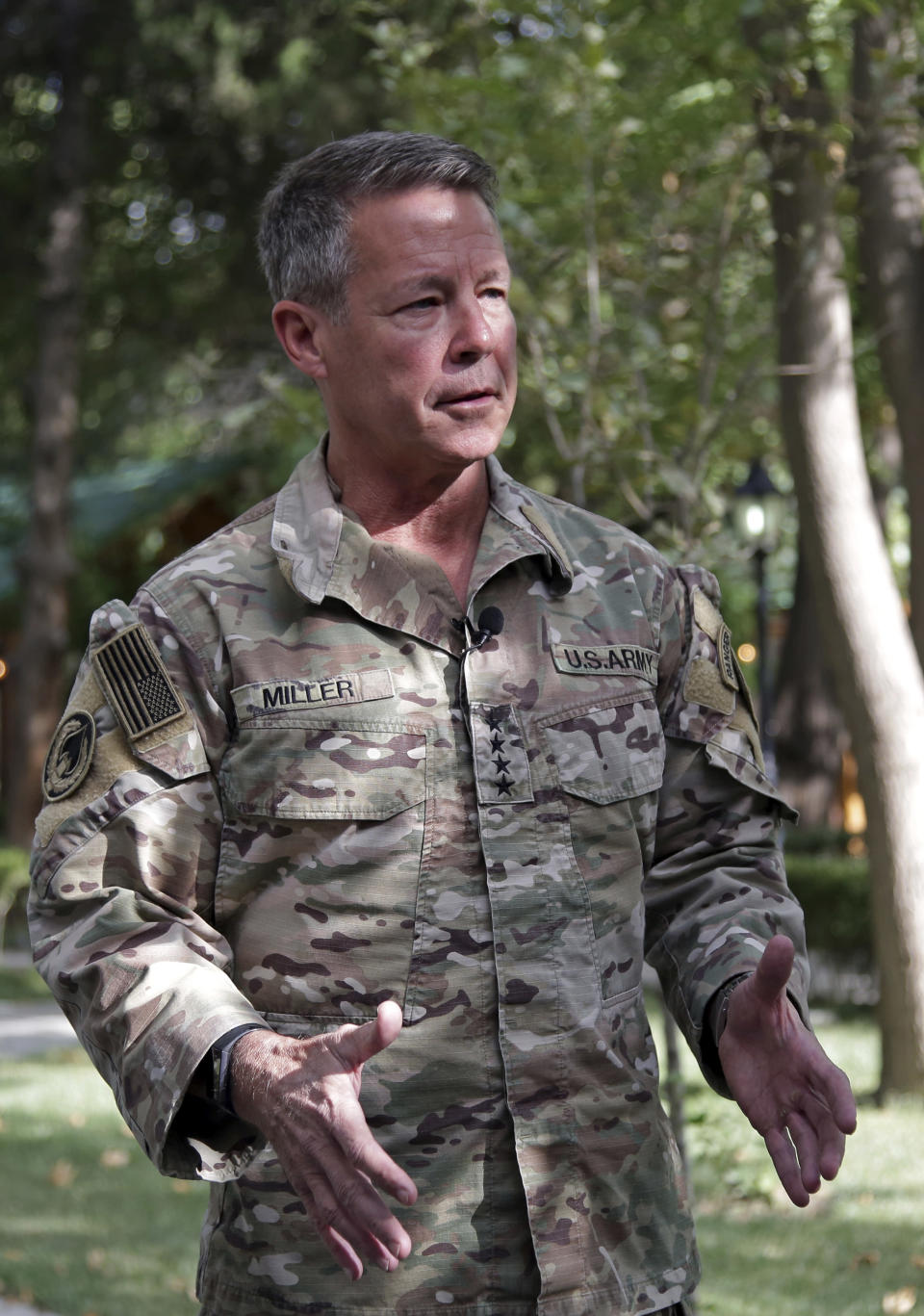 """U.S. Army Gen. Austin S. Miller, the U.S.'s top general in Afghanistan, speaks to journalists at the Resolute Support headquarters, in Kabul, Afghanistan, Tuesday, June 29, 2021. Miller on Tuesday gave a sobering assessment of the country's deteriorating security situation as America winds down its so-called """"forever war."""" He pointed to the rapid loss of districts around the country — several with significant strategic value — and said he fears the militias deployed to help the security forces could lead the country into civil war. (AP Photo/Ahmad Seir)"""