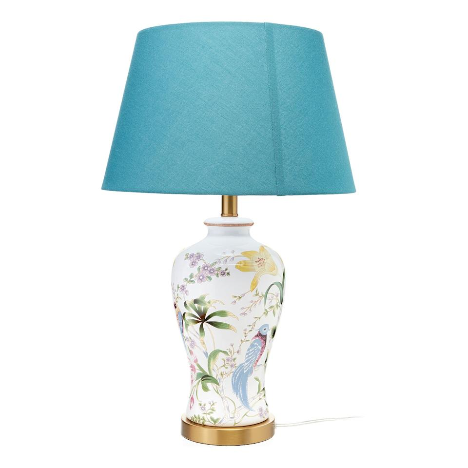 """<p>This <product href=""""https://www.walmart.com/ip/Floral-White-Ceramic-Table-Lamp-with-Teal-Shade-by-Drew-Barrymore-Flower-Home/445656216"""" target=""""_blank"""" class=""""ga-track"""" data-ga-category=""""internal click"""" data-ga-label=""""https://www.walmart.com/ip/Floral-White-Ceramic-Table-Lamp-with-Teal-Shade-by-Drew-Barrymore-Flower-Home/445656216"""" data-ga-action=""""body text link"""">Drew Barrymore Flower Home Floral White Ceramic Table Lamp</product> ($79) is such a pretty accent piece.</p>"""