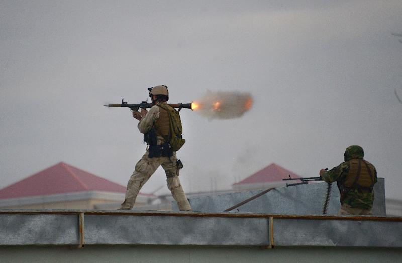 An Afghan Quick Reaction Force (QRF) soldier fires a rocket-propelled grenade launcher during an operation near the Indian consulate in Mazar-i-Sharif on January 4, 2016 (AFP Photo/Farshad Usyan )