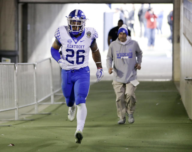 Kentucky running back Benny Snell Jr. (26) runs to the locker room after being ejected in the first half of the Music City Bowl NCAA college football game against Northwestern, Friday, Dec. 29, 2017, in Nashville, Tenn. (AP Photo/Mark Humphrey)