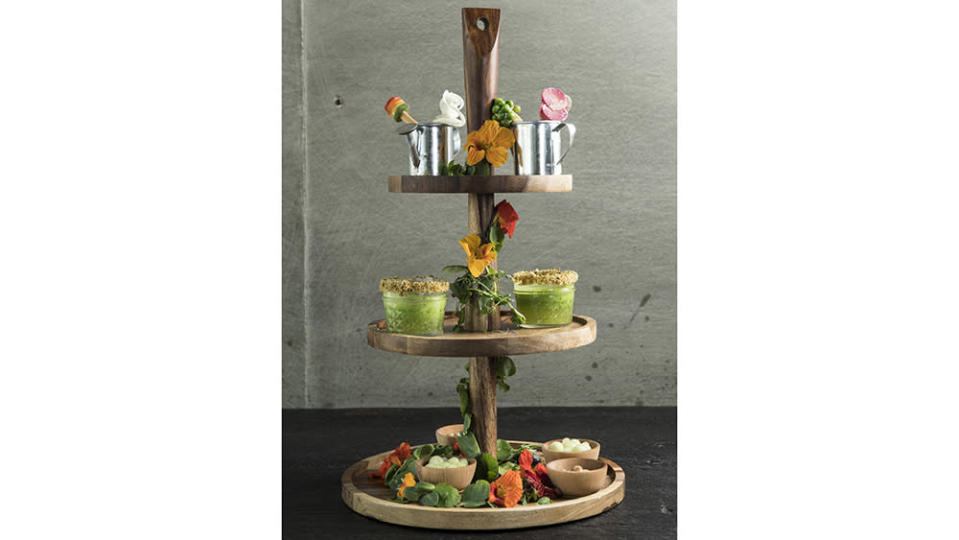 """Dirt Candy's """"Tower of Terroir,"""" layered with edible nasturtiums. - Credit: Evan Sung"""