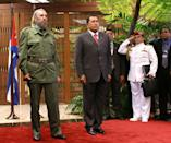 <p>Cuban President Fidel Castro, left, and Venezuelan President Fidel Castro are seen Tuesday, Dec.14, 2004 during a welcoming ceremony at the Revolution Palace in Havana, Cuba. (AP Photo/Jose Goitia) </p>