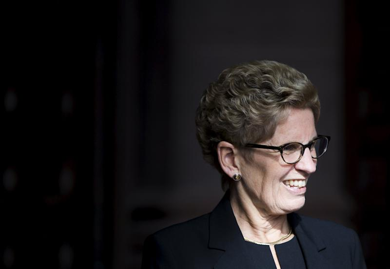 Ontario Premier Wynne smiles as she awaits Canada's PM designate Trudeau to arrive Queen's Park in Toronto