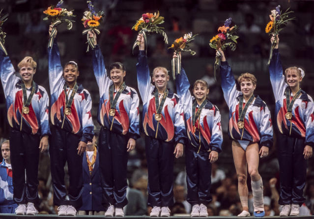 Kerri Strug (second from right) and the 1996 U.S. women's gymnastics team were nicknamed the Magnificent Seven. (Photo by David Madison/Getty Images)