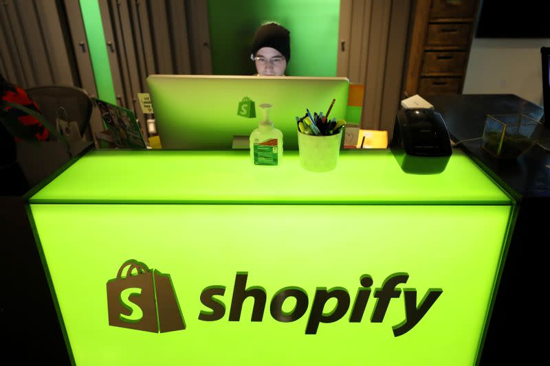 An employee works at Shopify's headquarters in Ottawa