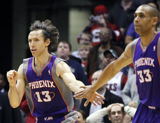 Phoenix Suns' Steve Nash (13) celebrates his game-winning shot with teammate Grant Hill (33) during the second half of an NBA basketball game against Milwaukee Bucks on Tuesday, Feb. 7, 2012, in Milwaukee. The Suns won 107-105. (AP Photo/Jeffrey Phelps)