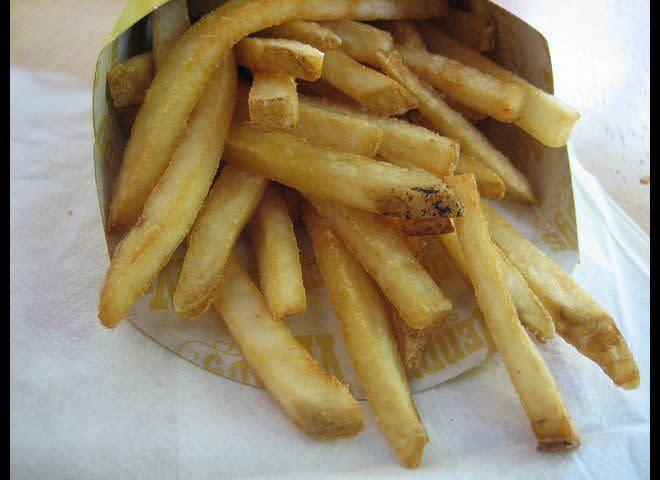 """In March 2012, a woman claimed she found a <span>live maggot</span> in her fries. According to Wendy's, the local health department determined that a Noctuid Moth larva, found only in outdoor habitats, was provided to them by the woman as the """"maggot."""" The health department found no evidence of any health violations in follow-up inspections of the Wendy's facility after the woman's claim. <em>Photo from <span>Flickr: theimpulsivebuy</span></em>"""