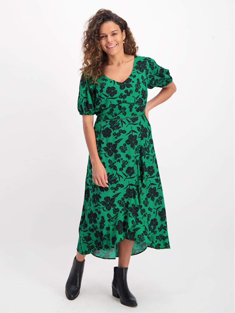 Grownups can get in on the fun with this $25 green ruffled wrap dress. Photo: Best&Less (supplied.)