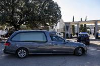 The car carrying the coffin of late dictator Gen. Francisco Franco arrives at Mingorrubio's cemetery, outskirts of Madrid, Thursday, Oct. 24, 2019. Spain has exhumed the remains of Spanish dictator Gen. Francisco Franco from his grandiose mausoleum outside Madrid and flown them by helicopter for reburial in a small family crypt north of the capital. The government-ordered, closed-door operation on Thursday satisfies a decades-old desire of many in Spain who considered the vainglorious mausoleum that Franco built an affront to the tens of thousands who died in Spain's Civil War and his subsequent regime as well as to Spain's standing as a modern democratic state. (AP Photo/Bernat Armangue)