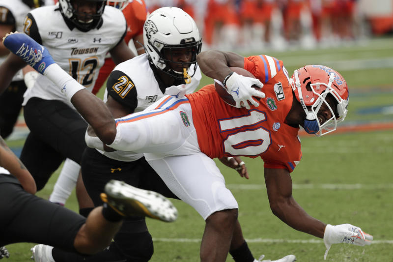 Florida wide receiver Josh Hammond (10) is tackled by Towson linebacker Chizurum Umunakwe (21) after a pass reception during the first half of an NCAA college football game, Saturday, Sept. 28, 2019, in Gainesville, Fla. (AP Photo/John Raoux)