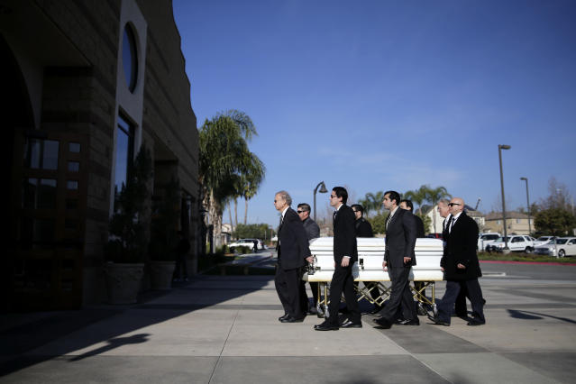 In this Friday, Jan. 10, 2014 photo, pallbearers carry the casket of Mikey Cortez into a church during a funeral service for Cortez, in Murietta, Calif. As his 7-year-old son Mikey lay in a hospital bed on life support, the victim of a drunk driver who had smashed into the car he was riding in, Paul Cortez took the boy's hand and made a solemn promise to God: If his son survived, no matter in what condition, he and his family would always be there for him. Although he would never emerge from the persistent vegetative state his father had found him in that night, Mikey's family was not only there for him but also gave him a full life. A life, as it turned out, not all that different from anybody else's, with cross-country family vacations and visits to Disneyland. (AP Photo/Jae C. Hong)