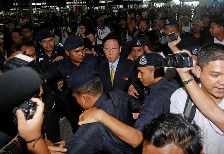 North Korean Ambassador to Malaysia Kang Chol (C), who was expelled from Malaysia, is surrounded as he arrives at Kuala Lumpur international airport in Sepang, Malaysia March 6, 2017. REUTERS/Lai Seng Sin
