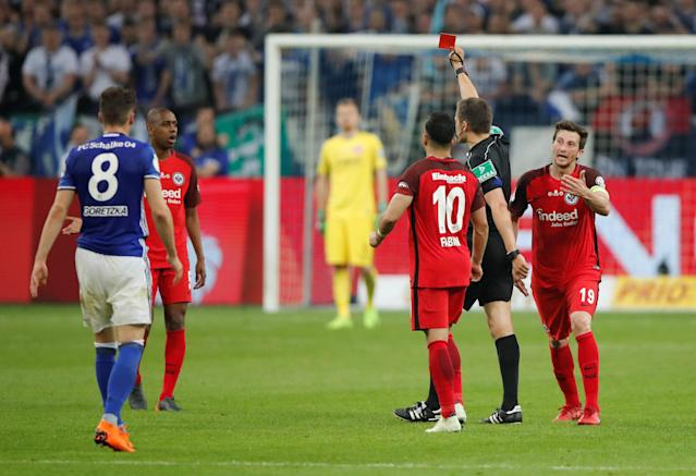 Soccer Football - DFB Cup - Schalke 04 vs Eintracht Frankfurt - Veltins-Arena, Gelsenkirchen, Germany - April 18, 2018 Eintracht Frankfurt's Gelson Fernandes is shown a red card by referee Robert Hartmann REUTERS/Wolfgang Rattay DFB RULES PROHIBIT USE IN MMS SERVICES VIA HANDHELD DEVICES UNTIL TWO HOURS AFTER A MATCH AND ANY USAGE ON INTERNET OR ONLINE MEDIA SIMULATING VIDEO FOOTAGE DURING THE MATCH.