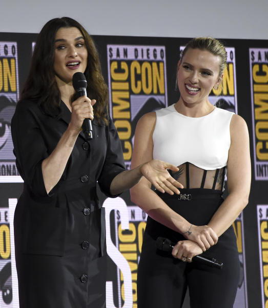 """Rachel Weisz, left, and Scarlett Johansson participate during the """"Black Widow"""" portion of the Marvel Studios panel on day three of Comic-Con International on Saturday, July 20, 2019, in San Diego. (Photo by Chris Pizzello/Invision/AP)"""