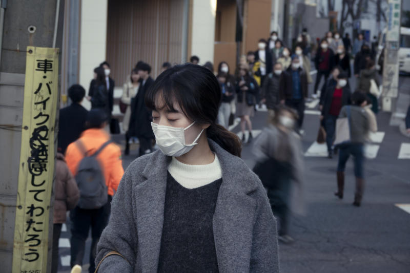 Wearing a face mask on the street / in public is not an unusual thing in Japan. Especially in winter or pollen season. Also, many people believe masks can protect themselves from infectious disease.