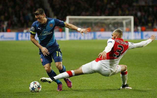 Football - AS Monaco v Arsenal - UEFA Champions League Second Round Second Leg - Stade Louis II, Monaco - 17/3/15 Arsenal's Mesut Ozil in action with Monaco's Aymen Abdennour Action Images via Reuters / John Sibley Livepic EDITORIAL USE ONLY.