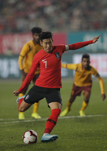 South Korea's Son Heung-min scores from a penalty against Sri Lanka during their Asian zone Group H qualifying soccer match for the 2022 World Cup at Hwaseong Sports Complex in Hwaseong, South Korea, Thursday, Oct. 10, 2019. (AP Photo/Lee Jin-man)