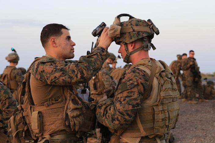 In this image released by the US Department of Defense, US Marine Corps 1st Lt. Mark Robinson inspects Cpl. Ian Juarena's equipment, at Camp Lemonnier, Djibouti, before boarding a KC-130J Marine Super Hercules on December 24, 2013 (AFP Photo/Robert L. Fisher Iii)