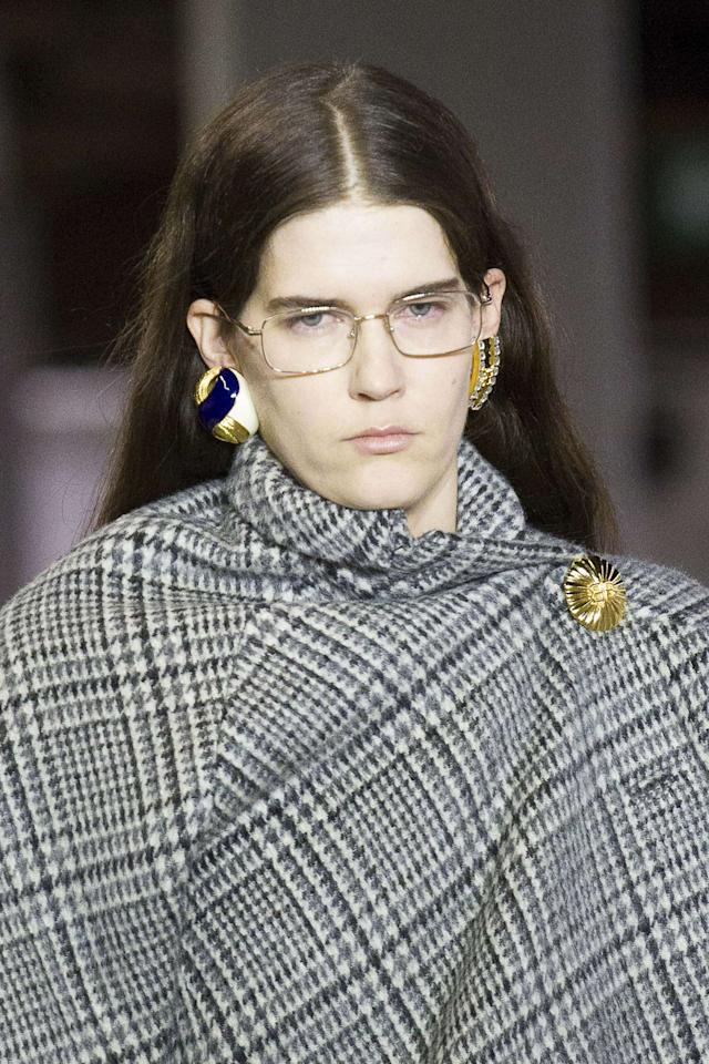 "<p>Square frames were huge in the '90s and there has been a resent surge of this shape. <a rel=""nofollow"" href=""http://http://www.neimanmarcus.com/Balenciaga/Designers/cat43240829/c.cat"">Balenciaga</a> presented a fresh metal pair that, oddly enough, also feel a bit futuristic.</p><p>Buy it <a rel=""nofollow"" href=""https://click.linksynergy.com/fs-bin/click?id=93xLBvPhAeE&subid=0&offerid=542834.1&type=10&tmpid=5459&RD_PARM1=http%253A%252F%252Fwww.bergdorfgoodman.com%252FTOM-FORD-Two-Tone-Square-Optical-Frames-Champagne%252Fprod120410041___%252Fp.prod&u1=IS%2CFAS%2CGAL%2CTryTheseOpticalEyewearTrendsStraightfromtheRunway%2Clwilliams0264%2C201801%2CT"">here</a> for $405.</p>"