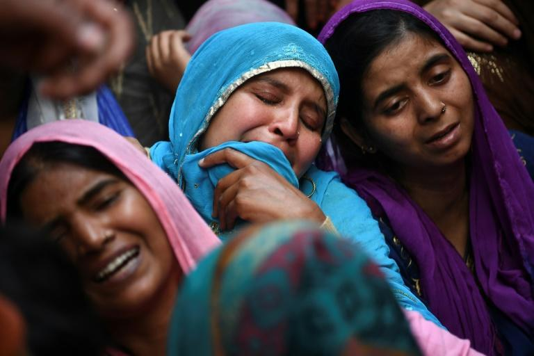 Relatives of Mohammad Mudasir, 31, who died in the sectarian riots in India's captial over Prime Minister Narendra Modi's citizenship law, mourn during his funeral in New Delhi