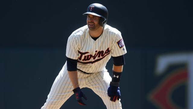 Despite struggles, fantasy owner should stick with Minnesota Twins' Brian Dozier in the long run, says Michael Salfino. (AP Photo/Jim Mone)