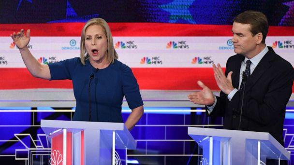 PHOTO: Kristen Gillibrand and Michael Bennet participate in the second night of the first 2020 democratic presidential debate at the Adrienne Arsht Center for the Performing Arts in Miami, June 27, 2019. (Saul Loeb/AFP/Getty Images)