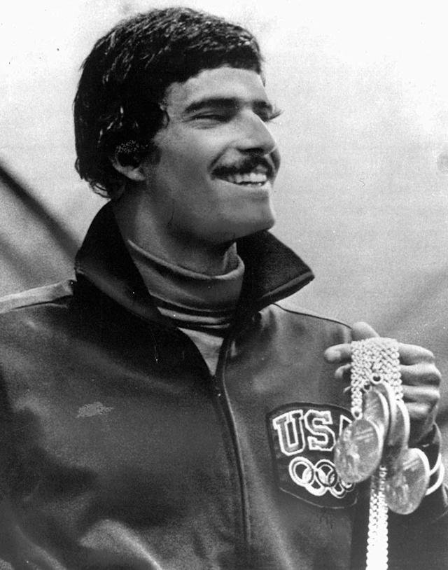 ** FILE ** In this August 31, 1972, file photo, American swimmer Mark Spitz holds five of the seven gold medals he won at the Olympics in Munich, Germany. In an interview Wednesday, July 2, 2008, with The Associated Press, the star of the 1972 Munich Games left little doubt that he expects his 36-year-old mark to be on the Olympic books for only another month or so. Michael Phelps will attempt to break Spitz's record of seven gold medals at the Olympics in Beijing. (AP Photo/Pool, FILE)