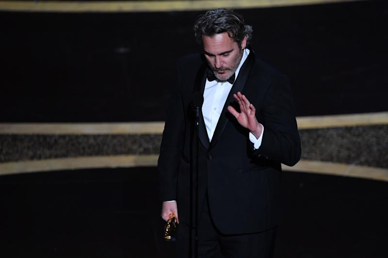 "US actor Joaquin Phoenix accepts the award for Best Actor in a Leading Role for ""Joker"" onstage during the 92nd Oscars at the Dolby Theatre in Hollywood, California on February 9, 2020. (Photo by Mark RALSTON / AFP) (Photo by MARK RALSTON/AFP via Getty Images)"