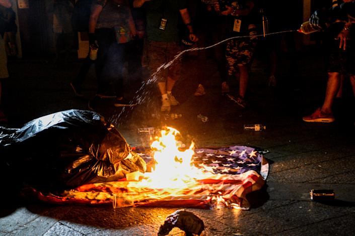 Demonstrators burn a U.S. flag during clashes with police on the fifth day of protests calling for the resignation of Governor Ricardo Rossello in San Juan, Puerto Rico July 17, 2019.  (Photo: Gabriella N. Baez/Reuters)