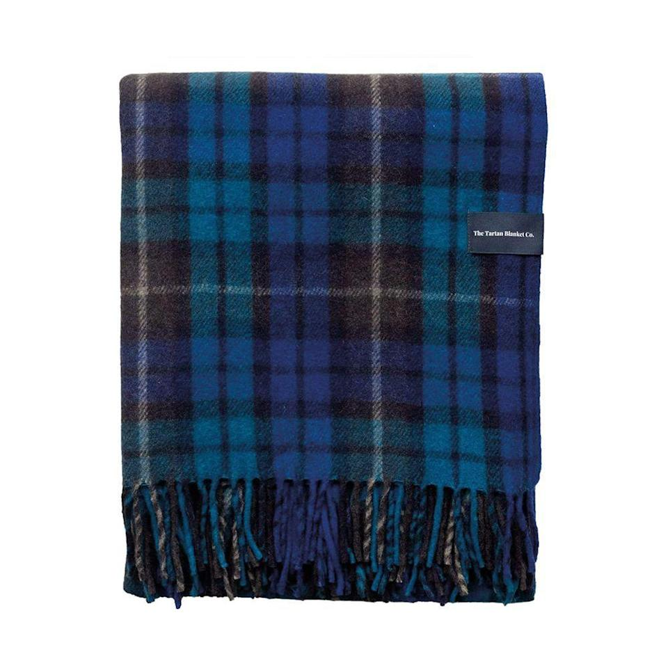 """<p><strong>The Tartan Blanket Co.</strong></p><p>amazon.com</p><p><strong>$110.00</strong></p><p><a href=""""https://www.amazon.com/dp/B08DDF8643?tag=syn-yahoo-20&ascsubtag=%5Bartid%7C10051.g.36317445%5Bsrc%7Cyahoo-us"""" rel=""""nofollow noopener"""" target=""""_blank"""" data-ylk=""""slk:Shop Now"""" class=""""link rapid-noclick-resp"""">Shop Now</a></p><p>Created by co-founders and co-parents Emma and Furgus Macdonald, The Tartan Blanket Co. takes inspiration from Scottish traditions. Their recycled wool blanket is a splurge you can feel good about as the brand has <a href=""""https://tartanblanketco.com/pages/our-positive-impact-company-pledge"""" rel=""""nofollow noopener"""" target=""""_blank"""" data-ylk=""""slk:1% for the planet, 1% for the people commitment"""" class=""""link rapid-noclick-resp"""">1% for the planet, 1% for the people commitment</a>, where 2% of all revenue goes toward helping to protect the planet and supporting people in need.</p>"""
