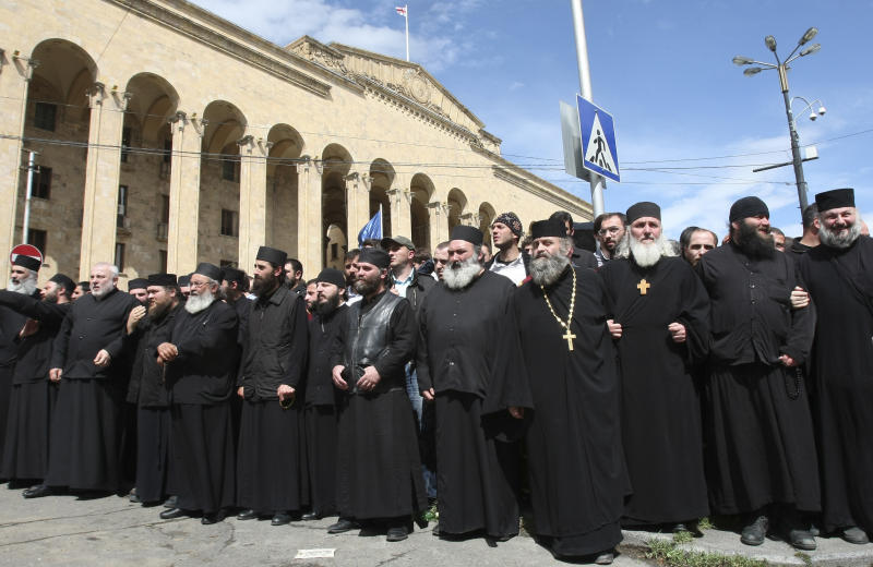 Georgian church clergymen and activists protesting against a gay pride rally in Tbilisi, Georgia, Friday, May 17, 2013. Thousands of anti-gay protesters, including Orthodox priests, occupied a central street in Georgia's capital Friday, with some threatening to lash with nettles any participant in a gay pride parade which was to take place there. Police in Tbilisi guarded several dozen gay activists and bused them out of the city center shortly after they arrived at the gathering. (AP Photo/Shakh Aivazov)