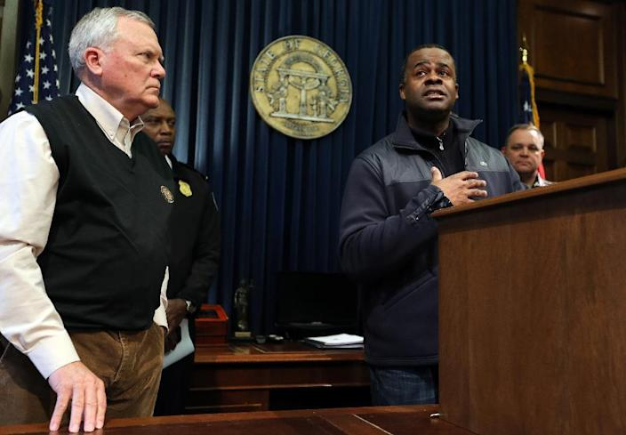 Atlanta Mayor Kasim Reed responds to a pointed question about the city's response to the snow storm as Gov. Nathan Deal looks on, during a news conference Wednesday, Jan. 29, 2014 in the Governor's office at the State Capitol in Atlanta. A rare snowstorm left thousands across the U.S. South frozen in their tracks, with workers sleeping in their offices, students camping in their schools, and commuters abandoning cars along the highway to seek shelter in churches or even grocery stores. (AP Photo/Atlanta Journal-Constitution, Ben Gray) MARIETTA DAILY OUT; GWINNETT DAILY POST OUT; LOCAL TV OUT; WXIA-TV OUT; WGCL-TV OUT