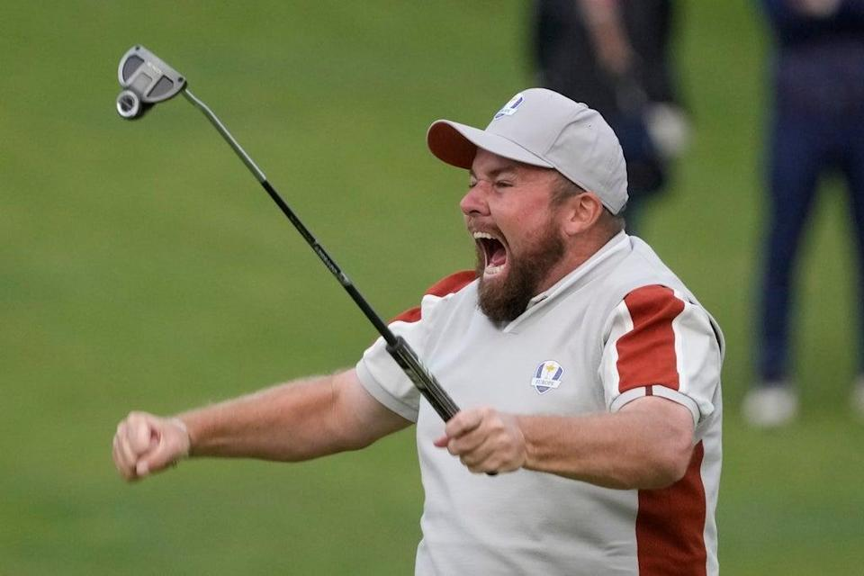 Team Europe's Shane Lowry celebrates on the 18th hole after winning his match with Tyrrell Hatton (Charlie Neibergall/AP) (AP)