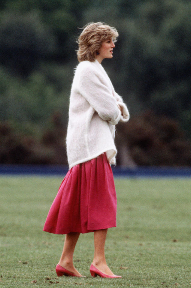 <p>Today, chunky jumpers worn with midi skirts are a transseasonal go-to, but Diana was wearing the outfit combo decades ago. <em>[Photo: PA]</em> </p>