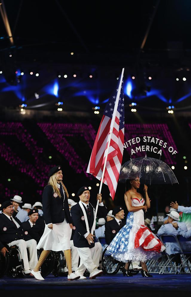 LONDON, ENGLAND - AUGUST 29: Athlete Scott Danberg of United States carries the flag during the Opening Ceremony of the London 2012 Paralympics at the Olympic Stadium on August 29, 2012 in London, England. (Photo by Clive Rose/Getty Images)
