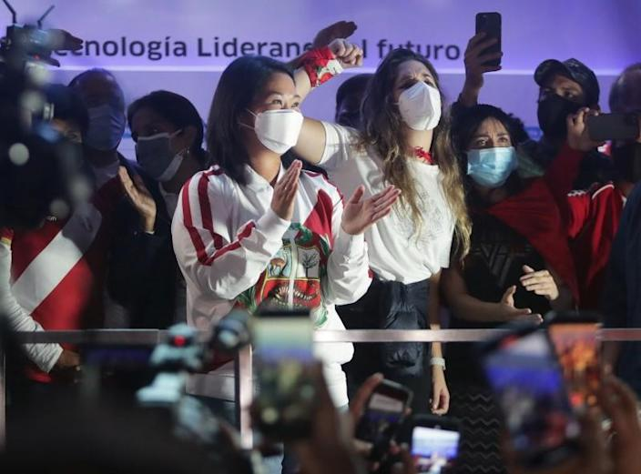 FILE PHOTO: Peru's presidential candidate Keiko Fujimori applauds to supporters while leading a demonstration in Lima