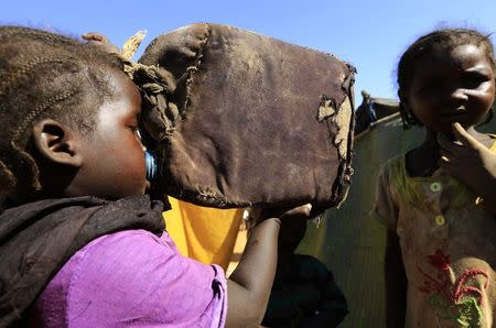 A child drinks water at the Zamzam IDP camp in North Darfur