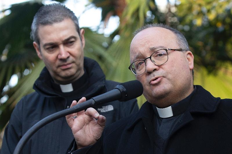 A visit from the Vatican's top abuse investigator Archbishop Charles Scicluna (R, pictured June 2018) may result in a series of resignations by Polish bishops (AFP Photo/Claudio REYES)