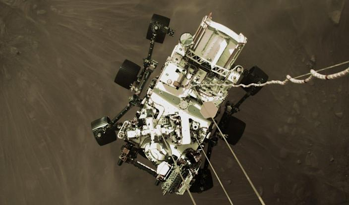 NASA's Perseverance rover is lowered onto the surface of Mars in a harrowing landing.